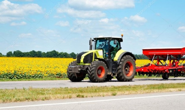 depositphotos_80940172-stock-photo-tractor-on-the-road
