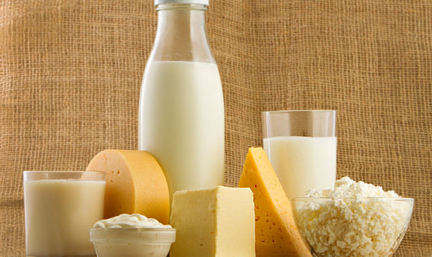 Fresh dairy products over wooden background.