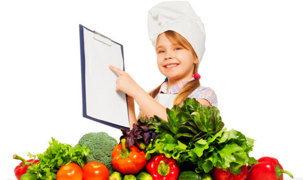 Smiling girl in cook's uniform with shopping list