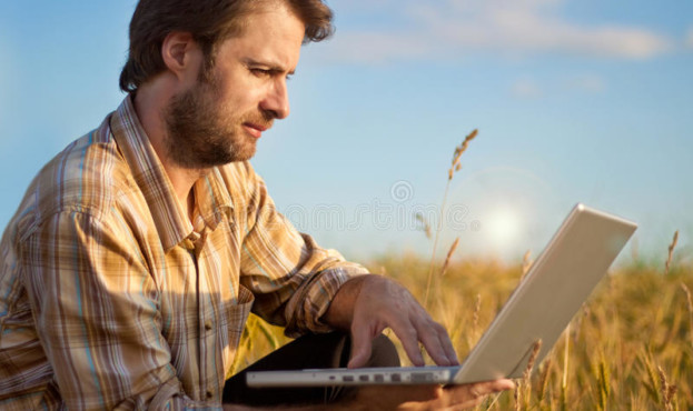 modern-farmer-wheat-field-laptop-forty-years-old-checking-his-working-computer-32199035