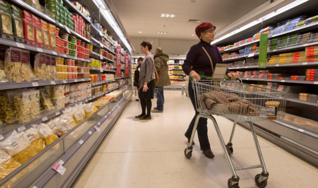 FILE PHOTO: Shoppers browse the aisles in the Canary Wharf store of Waitrose in London