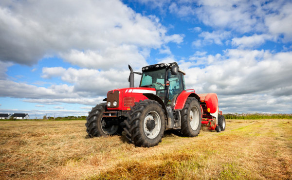 depositphotos_7293165-stock-photo-tractor-collecting-haystack-in-the