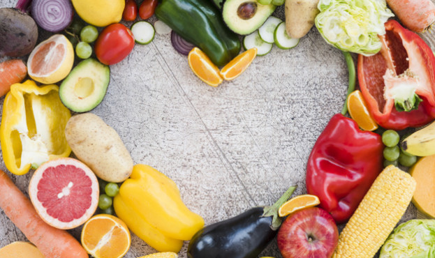 heart-shape-made-with-colorful-vegetables-textured-backdrop_23-2148165582