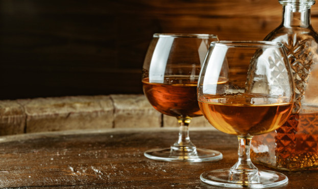 cognac-whiskey-glasses-rustic-table_127657-24990