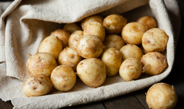 new potatoes with the peel on the table in a bag