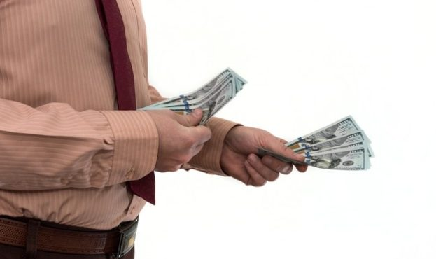 businessman-buying-or-renting-a-product-or-service-giving-dollars-isolated-on-white-the-male-hand-offers-a-bribe_359031-140