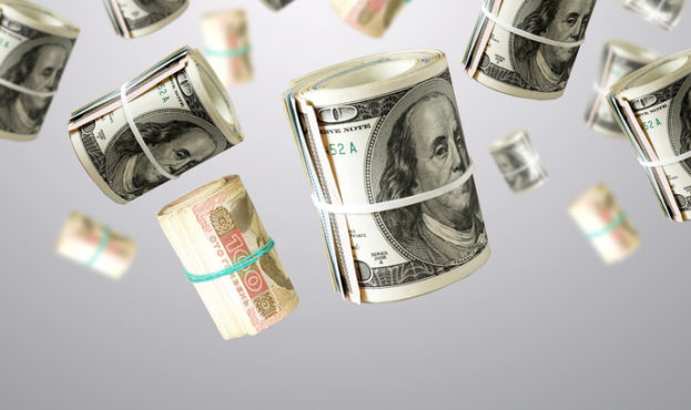 Rolls Of Unaited states Dollars and Ukrainian money. Abstract money background