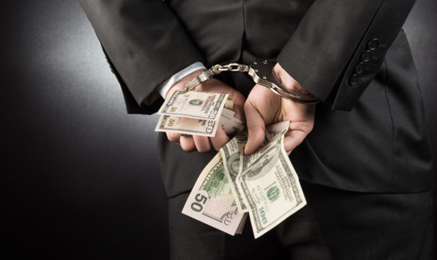 Businessman is arrested and handcuffed with dollar
