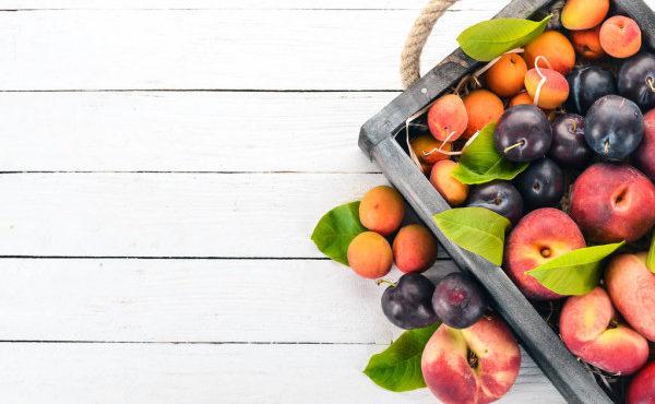 depositphotos_206537556-stock-photo-fresh-fruits-in-a-wooden