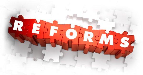 depositphotos_80348806-stock-photo-reforms-white-word-on-red