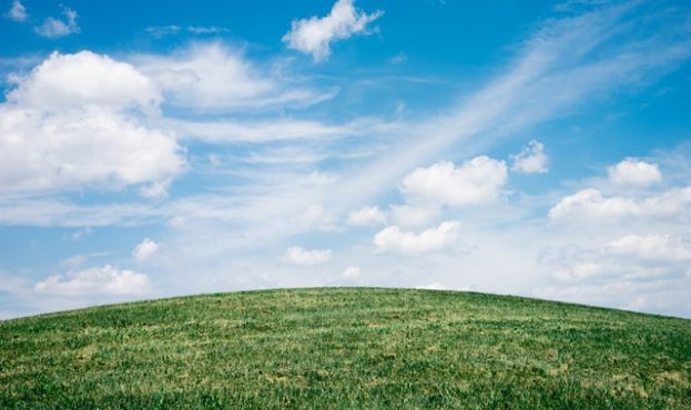 green-grass-field-under-white-clouds-1048039