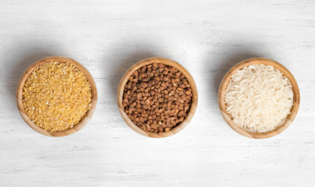 wheat-buckwheat-and-rice-in-wooden-plates-the-view-from-the-top_76158-109