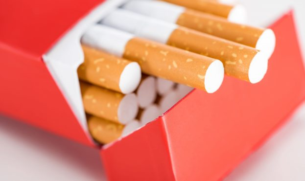 close-up-shot-of-cigarettes-in-red-pack-W3RE92X-scaled