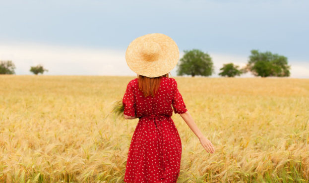 redhead-girl-in-red-dress-at-wheat-field_87910-1627