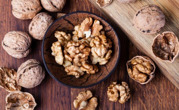depositphotos_101346576-stock-photo-walnuts-isolated-on-a-wooden
