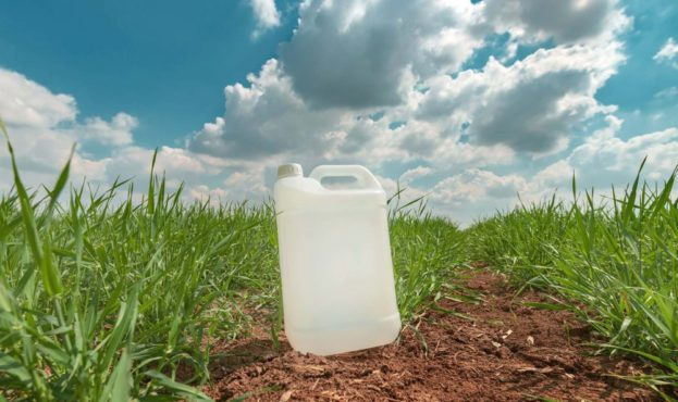 blank-pesticide-jug-container-mock-up-in-wheatgras-FRDNYME-min-1000x600