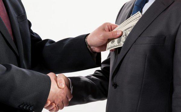 depositphotos_25236787-stock-photo-giving-a-bribe-into-a